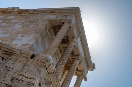 Temple of Athena Nike on the Acropolis of Athens against the light, Greece