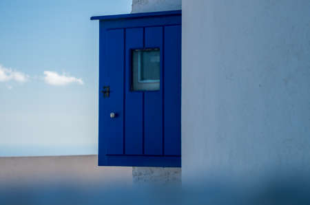 Santorini typical blue painted details in the city of Oia, Greece, wooden wall cabin Archivio Fotografico