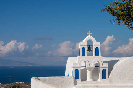 Church bells on a Greek Orthodox Church overlooking the Aegean Sea in the town of Oia on the island of Santorini Archivio Fotografico