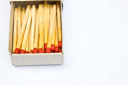 pyromaniac: Matches in box on a white background