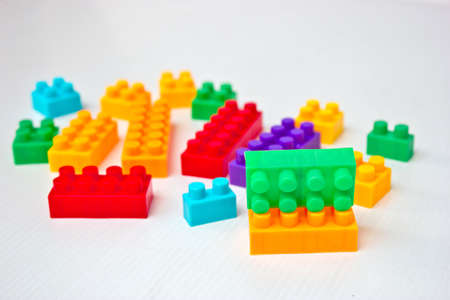 Toy colorful plastic blocks on white background photo