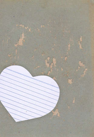 Paper heart over grunge background for text photo