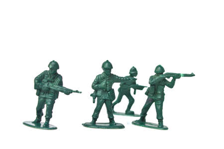green military miniature: Plastic toy soldiers on white background
