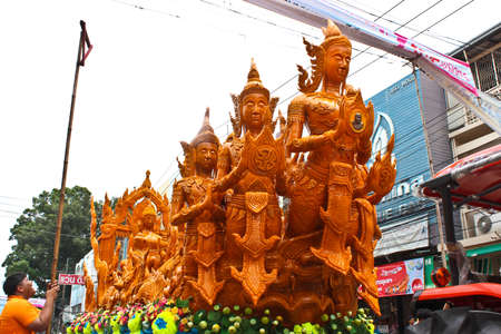 orenge: UBON RATCHATHANI, THAILAND - JULY 23 Ubon Ratchathani Candle Festival is the traditional well-known festival in I-san and the largest religious ceremony on July 23, 2013 in Ubon Ratchathani, Thailand