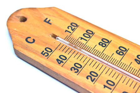 calibrated: Close up of a thermometer on white