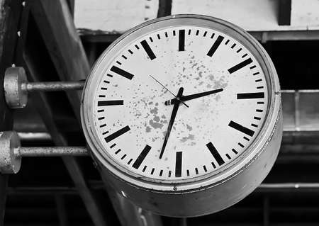 Old wall clock in black and white photo