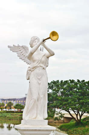 gabriel: a sculpture of Angel calling to Heaven Stock Photo