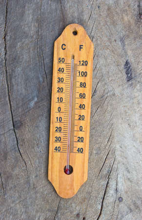 Wooden Thermometer with high temperature. Global warming concept photo