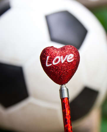 Red Heart With Football  I love soccer concept  photo