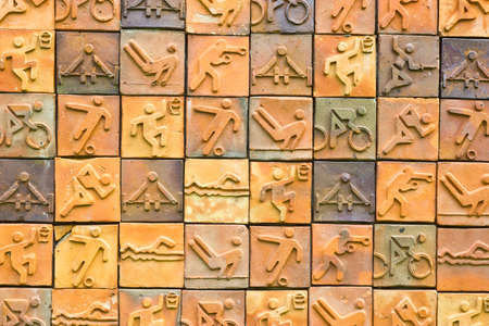 earthenware: Sport icon set  on earthenware brick wall. Sport pictogram Stock Photo