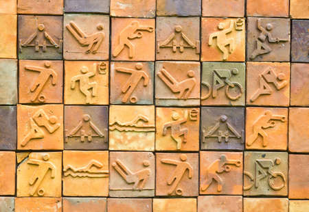 Sport pictogram. Sport icon set on earthenware brick photo