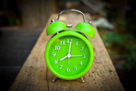 Old fashioned alarm clock at eight o