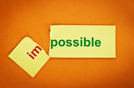 Filter image. Changing the word impossible transformed into possible. Conceptual of successfully overcoming problems. photo