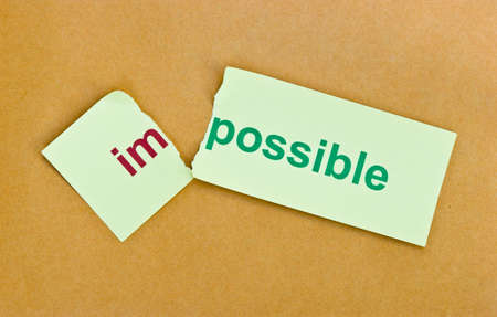 overcoming: Changing the word impossible to possible. Conceptual of successfully overcoming problems.