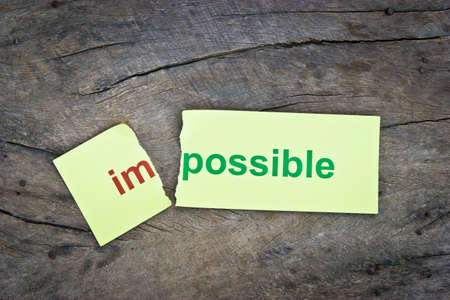 overcoming: Changing word impossible transformed to possible. Conceptual of successfully overcoming problems.