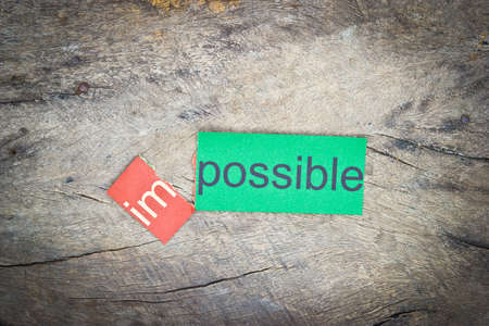 overcoming: Changing the word impossible transformed into possible. Conceptual of successfully overcoming problems. Stock Photo