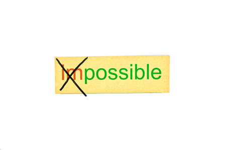 Changing the word impossible into possible.Concepts of problem solving and overcoming challenges. photo