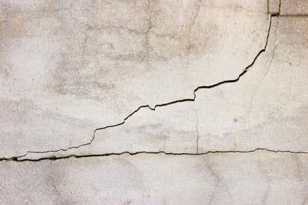 squalid: cracked concrete wall background. Stock Photo