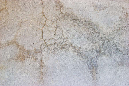 cracked concrete: cracked concrete wall background. Stock Photo