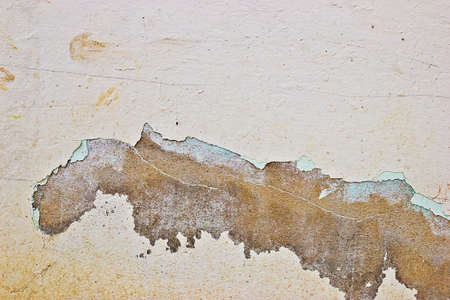 waif: Grunge cracked wall paint peeling off.