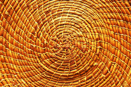 Circular background from rattan fibers. Wicker texture close-up photo. (filter image) photo