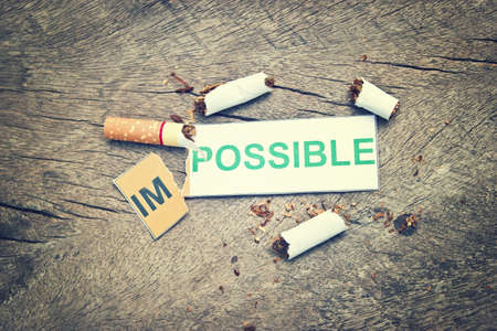 feasible: Changing word impossible to possible for quitting smoking concep. (filter image) Stock Photo