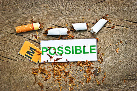 successfully: Changing word impossible transformed to possible. Concepts of successfully for quitting smoking or World no tobacco day) Stock Photo