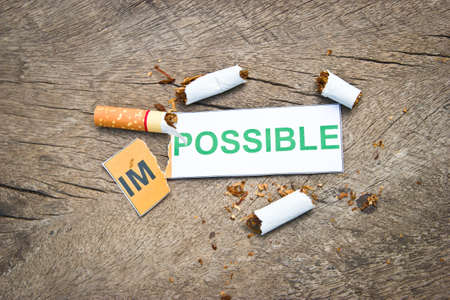 transformed: Changing word impossible transformed to possible. Concepts of successfully for quitting smoking or World no tobacco day) Stock Photo