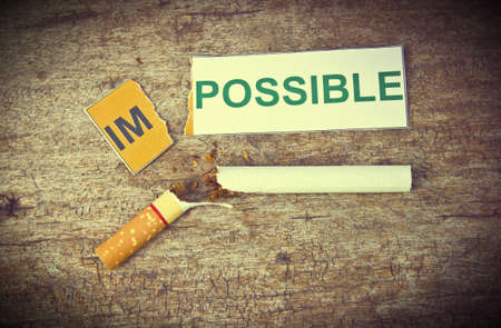 concep: Changing word impossible to possible for quitting smoking concep. Stock Photo