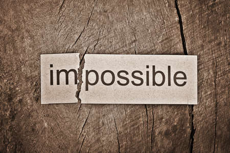 feasible: Changing word impossible transformed to possible. Conceptual of successfully overcoming problems.