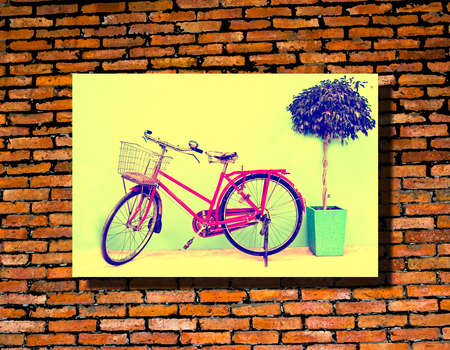 vintage photo: Vintage bicycle photo hang on brick wall. Stock Photo