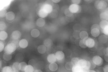 Abstract black and white blur bokeh background.