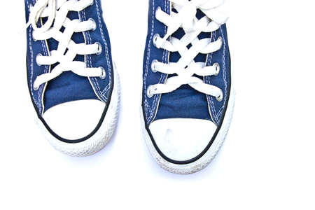 Over head of generic sneakers on white background.