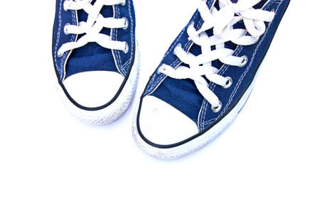 Top view of blue generic sneakers on white background.
