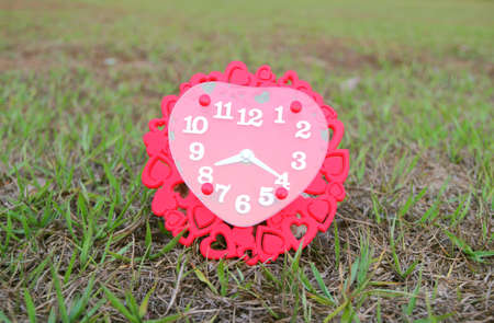 Valentines day background with red clock shaped heart. Date Love