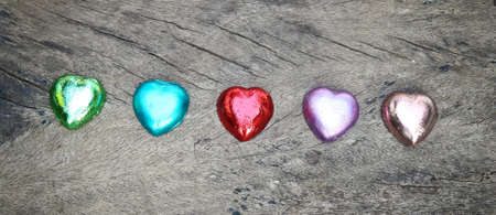 Valentines Day background with sweet hearts on wood background. Imagens
