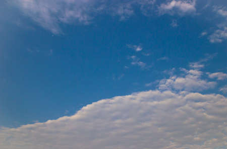 Blue sky background with clouds. Imagens