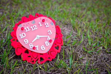 Valentines day background with red clock shaped heart.