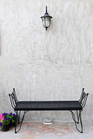 Black chairs on concrete wall. Living area. Imagens