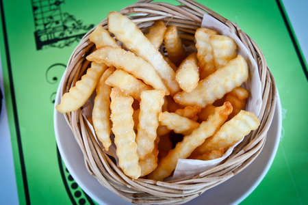 Golden French fries potatoes ready to be eaten Imagens