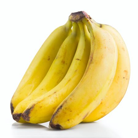 banana skin: mature group of bananas on a white background, isolated