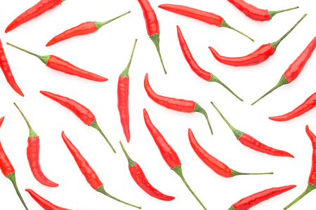 Fresh raw red chilli peppers on white background, isolated, full depth of field