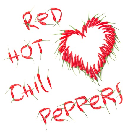text red chilli peppers, heart shape on white background, isolated Stock Photo