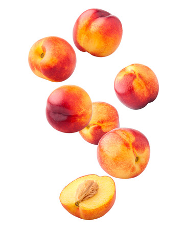 Falling Nectarine or peach isolated on white background, clipping path, full depth of field Zdjęcie Seryjne