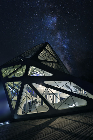 starry night: Flying tribe shape building under starry night