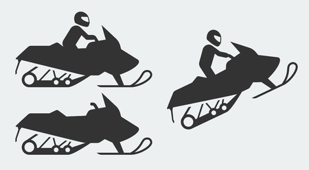 snowmobile: Snowmobiling silhouettes on gray background