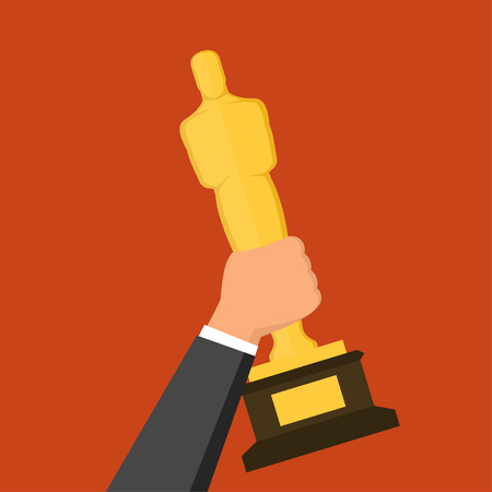statuette: Hand holding golden award statuette over red background. Flat design style illustration