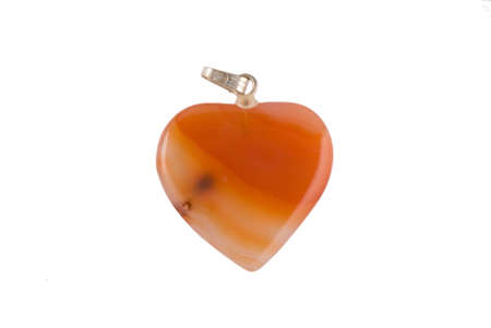 Cornelian heartshaped pendant isolated on white photo
