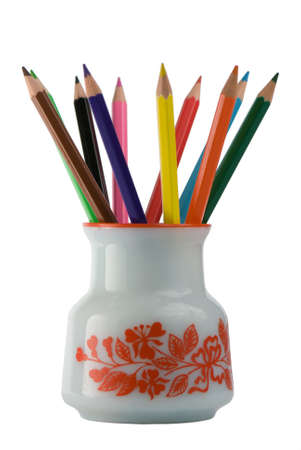 Colored pencils in jar isolated on white background photo