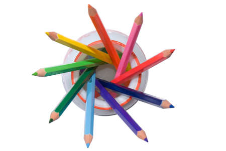 Seven colored pencils forms star. Isolated on white background photo